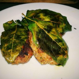 Beef Patties Cooked on Lemon Leaves
