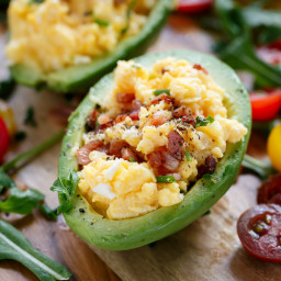 Cheesy Scrambled Eggs in Avocado With Crispy Bacon Pieces