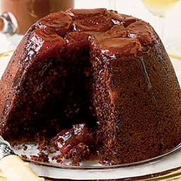 Chocolate and apricot pud with glossy chocolate sauce