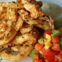 Crisp fried calamari with cucumber, roast tomato and feta salad