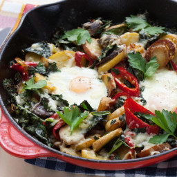 Fingerling Potato and Kale Hashwith Baked Eggs and Aged Cheddar Cheese
