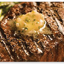 Fire grilled steak with steakhouse butter