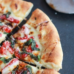 Green Olive Pesto Pizza with Roasted Red Peppers and Feta Stuffed Crust