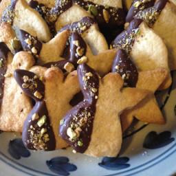 Lemon-cardamom cookies dipped in chocolate w/pistachio & salt sprinkles.