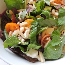 Mixed Greens Salad with Caramelized Onion, Tomato, Feta and Toasted Almonds