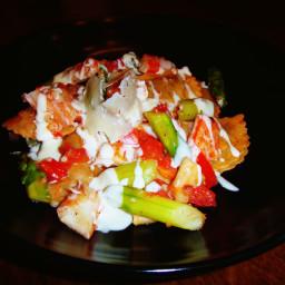 Mushroom ravioli with crab, asparagus, tomatoes and white wine cream sauce