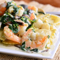 Ravioli with Seafood, Spinach  and  Mushrooms in Garlic Cream Sauce