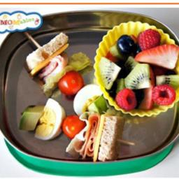 Unwrapped sandwich on a stick with fruit
