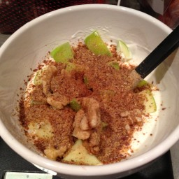 Warm apple with yoghurt, cinnamon, nutmeg, walnuts and flax
