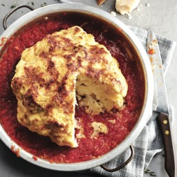 Whole-roasted cauliflower with tomato-pepper sauce