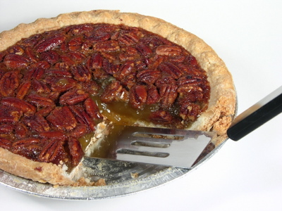 Pecan pie filling is a baked mixture of sugar, eggs, vanilla, pecans ...